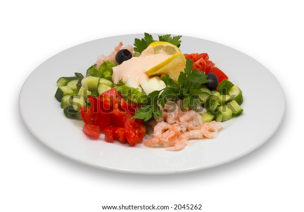shrimp salad with fresh vegetables, lemon and olives, isolated