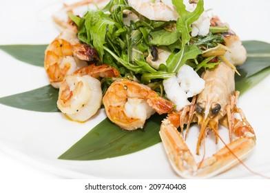 shrimp salad greens vegetables and crayfish in the restaurant