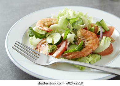 Shrimp salad with Japanese cucumber in top view dish