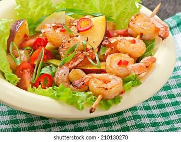 Shrimp salad with peaches, tomato, avocado and lettuce
