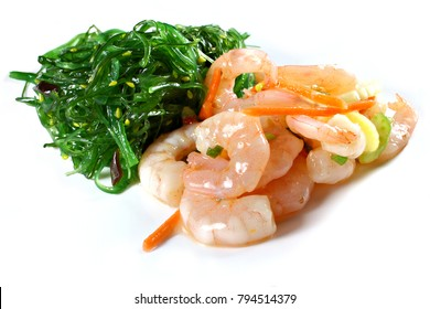 Shrimp salad with seaweed salad isolated on white, shallow focus