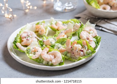 Shrimp salad wraps in lettuce leaves on a holiday table