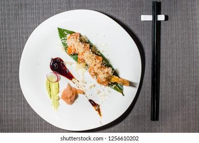 shrimp and salmon uramaki with bittersweet sauce, japanese fusion cousine