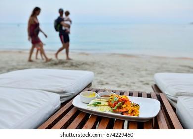 Shrimp satay on wood table at seaside
