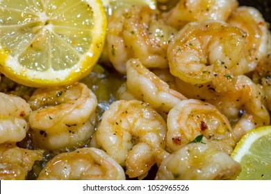 Shrimp Scampi being freshly sauteed with lemon, garlic, red pepper flakes and parsley