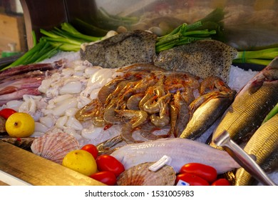 Shrimp scampi and other seafood on display in a restaurant in Venice, Italy