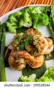 Shrimp scampi seafood dish with broccoli and asparagus.