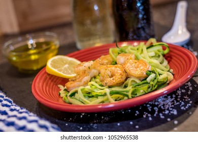 Shrimp Scampi served over zucchini noodles sauteed with lemon, garlic, butter and herbs