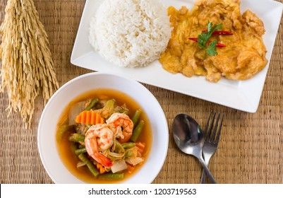 Shrimp sour soup mixed vegetable made of tamarind paste and omelet,cooked rice,Delicious typical Thai food style