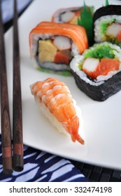 shrimp sushi with mixed sushi background on white plate
