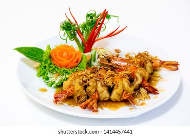 Shrimp with tamarind sauce : deep fried golden brown shrimp with tamarind sauce decorate with carot chili carving