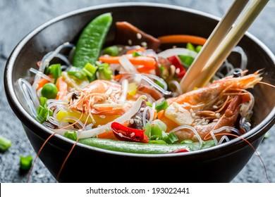 Shrimp and vegetables served with noodles
