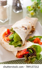 Shrimp with vegetables wrapped in a tortilla