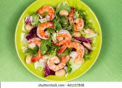 Shrimp and white bean salad. View from above, top studio shot