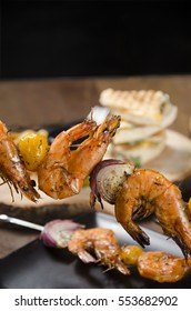 Shrimps barbecue on the wooden table.