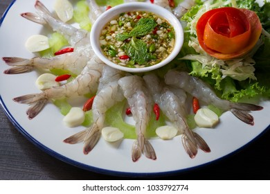 Shrimps chilled in fish sauce on white dish with vegetable and green spicy sauce Thai food / Blurred and selective focus, Still life, image and Still Life food