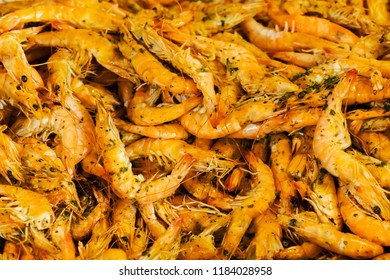 Shrimps fried on pan and fresh herbs