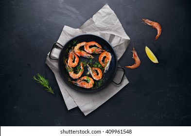 Shrimps in a frying on blackboard