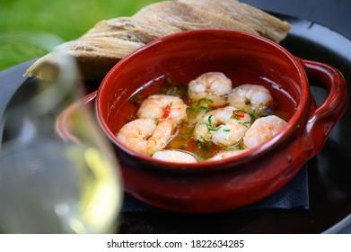 Shrimps in garlic oil in a restaurant table