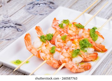 Shrimps with green butter sauce