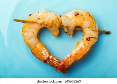 shrimps love on blue plate