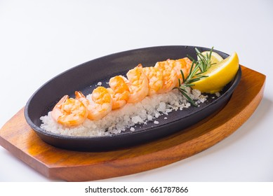 Shrimps on dish with salt