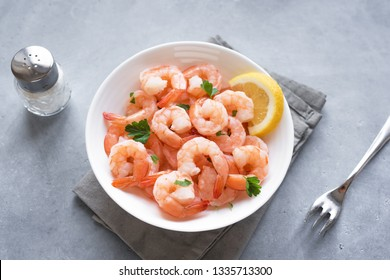 Shrimps, Prawns in bowl. Fresh seafood - shrimp tails with lemon. Boiled prawns.