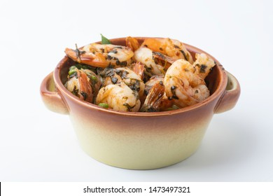 Shrimps provencal, Shrimp in Provencal in a pot  isolated on white background