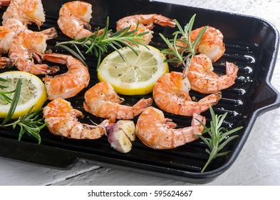 Shrimps roasted on grill pan with lemon, garlic and rosemary.