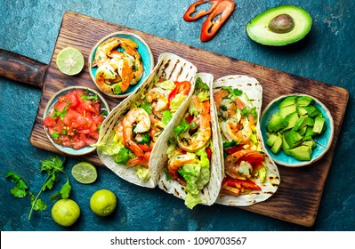 Shrimps tacos with salsa, vegetables and avocado. Mexican food.