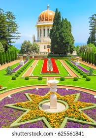Shrine of Bab with beautiful Bahai garden and blossoming flowers in star form flowerbed. Haifa, Israel.