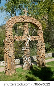 Shrines built from rocks at Chimayo Santuario in New Mexico where pilgrims travel seeking medical healing.