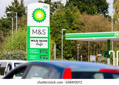 Shropshire UK - April 15 2017: Traffic passing by a BP Connect and Wild Bean cafe in a British filling station partnered with Marks and Spencer Simply food offering convenience store shopping
