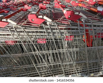 Shropshire, UK - February 11, 2019.  Shopping trollies chained together, outside a Sainsbury's supermarket.