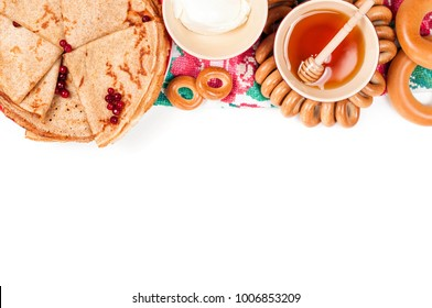 Shrovetide Maslenitsa (Butter Week) festival meal. Russian pancake blini with honey and fresh cream cheese on white background. Top view. Flat lay