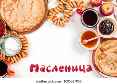 Shrovetide Maslenitsa festival meal. Russian pancake blini with raspberry jam, honey, fresh cream and red caviar on white background