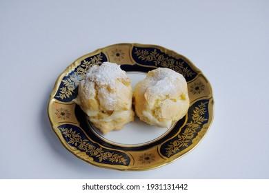 Shu cake. homemade shu cake with vanilla custard inside.