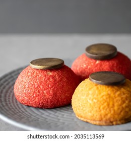 Shu cakes on a gray plate. Soft focus.