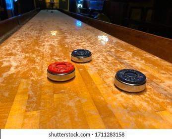 Shuffleboard closeup in Bar with lights