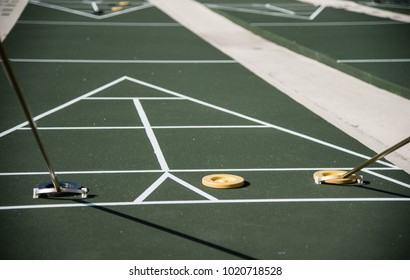 Shuffleboard court with game in progress
