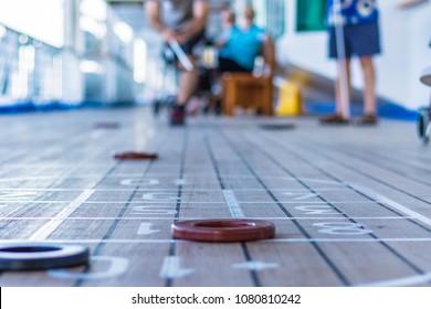 Shuffleboard game on cruise ship
