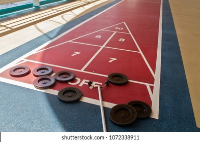 The shuffleboard game is ready to play on a cruise ship in the Caribean Sea