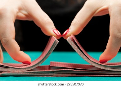 Shuffling playing cards on black background