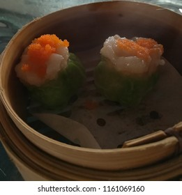 Shumai is famous chinese food is made of pork, prawn wrapped in special sheet and For meats roasted on spits over an open fire or a huge wood burning rotisserie oven.