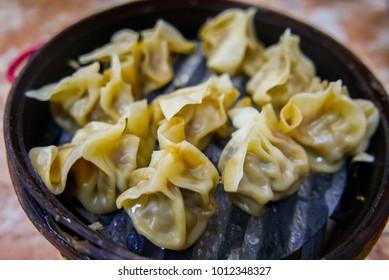 Shumai or Shaomai a Dim Sum Chinese traditional steamed dumplings food.