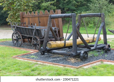 Shumeg, Hungary - September 10, 2014. Medieval battering ram on wheels and cart for projectiles