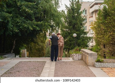 Shumen, Bulgaria - August 16, 2017. The lives of the residents of the city. An elderly couple on a walk.