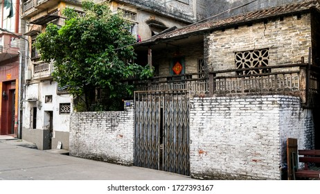 Shunde, Foshan, China - April 3, 2017:  old house in the small old town city in China, Asia, colonial architecture, British architecture, rich Easter Chinese culture, public streets, poverty in Asia