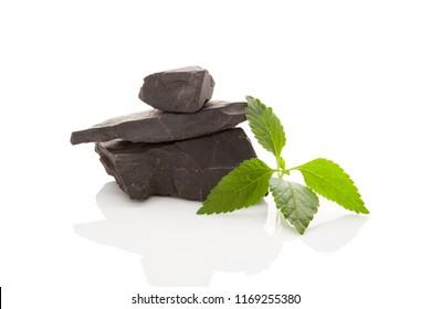 Shungite stones isolated on white background.