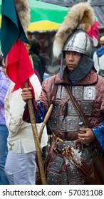 "SHUSHENSKOE, RUSSIA - JULY 9-11: Shushenskoe, the International festival of ethnic music ""Sayan Ring"". Man in ancient Mongolian soldier armour. July 9-11, 2010 in Shushenskoe, Russia."